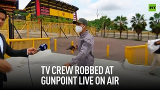 TV crew robbed at gunpoint live on air in Ecuador