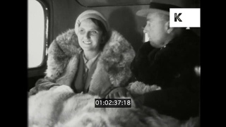 1930s Switzerland, Wealthy Couple Driving Through Snowy Mountains, 35mm