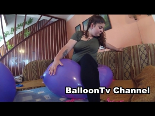 Balloontv channel girl sit to pop giant balloons