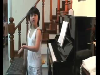 little Ten dancing in front of the piano, dont you think its cute